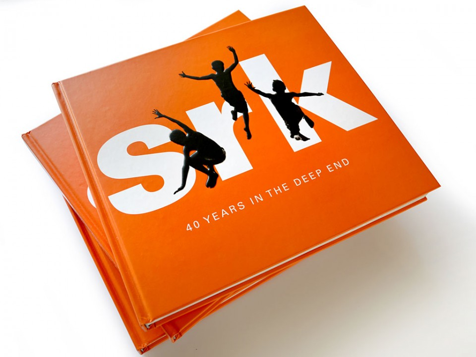 book design for the cover of SRK Consulting's 40 year history